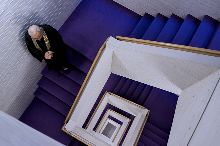 A monk walks on a stairwell in the Shinjuku Rurikoin Byakurengedo, a charnel house in the famous Tokyo shopping district.