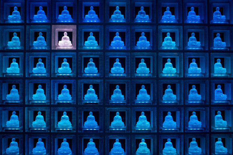 TOKYO, JAPAN - APRIL 06: A selected glass buddha alter is seen lit up at the Ruriden columbarium on April 6, 2015 in Tokyo, Japan. The Ruriden, operated by the Koukokuji buddhist temple, took two years to build and houses 2046 futuristic alters with glass buddha statues that correspond to drawers storing the ashes of the deceased. An IC card allows the owner of the alter to access the building and lights up the corresponding statue. The ashes are stored for 33 years before being buried below the Ruriden, currently 600 alters are in use and another 300 are reserved. (Photo by Chris McGrath/Getty Images)